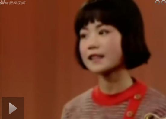 王菲14岁唱红歌